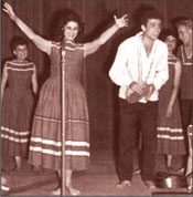 Israeli performers, Yaffa Yarkoni (left) and Ron Eliran, perfor-ming on stage at the Palais (Palace) de Shallot in Paris, France, in 1958 during the 10th anniversary celebrations in honor of the State of Israel.