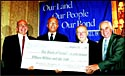 Comptroller William C. Thompson, Jr. holds a check representing NYC�s new $15 million Israel Bonds purchase. From left: Appelbaum; Thompson; Matza; and Michael J. Lazar. Photos: David Karp