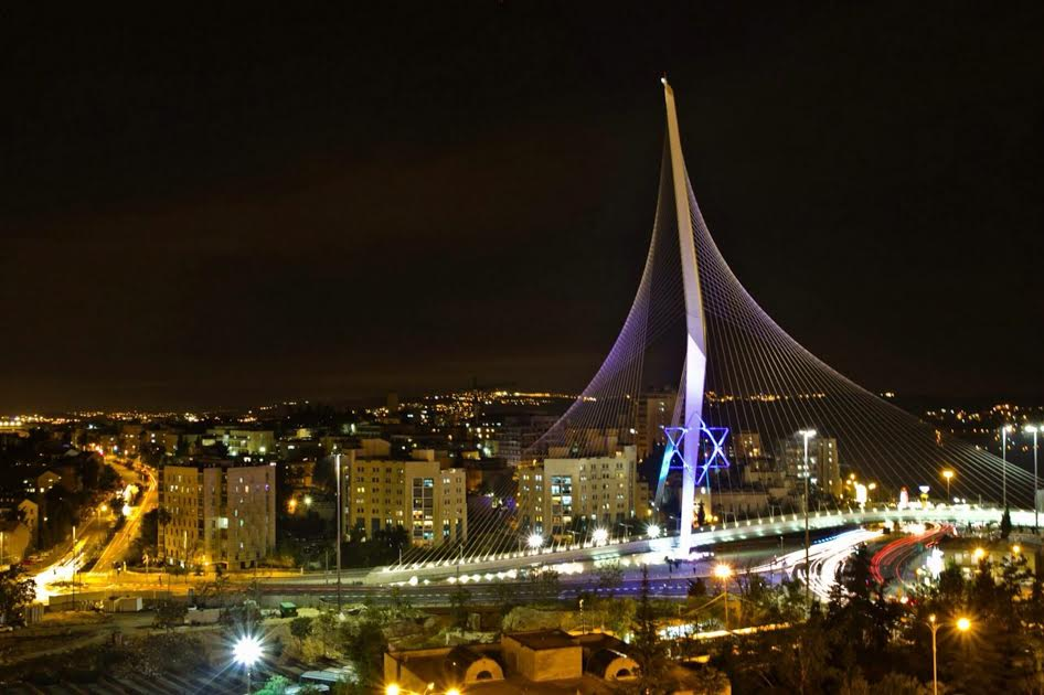 Jerusalem Municipality lit up The Bridge of Strings, also called the Chords Bridge or Jerusalem Light Rail Bridge, with a display of a 45 ft. tall Star of David in honor of Israel's 67th Independence Day.  The structure was designed by the Spanish architect and engineer Santiago Calatrava and is used by Jerusalem Light Rail's Red Line. Photo: Arnon Bosni/Jrslm Muni for Israel Sun