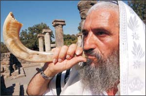 Shofar blowing at an ancient synagogue in Israel.