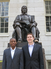 Standing beneath the statue of John Harvard, graduating Harvard Law School students Alexander Chester (r) and Darrell Bennett (l) made the case for the University's divestiture from Iran in the December 11, 2009 The Harvard Crimson. They then lobbied the 37 Harvard alumni who are members of Congress last February for their support.