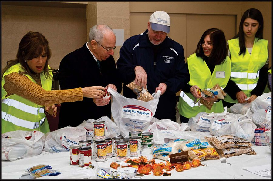 Jewish and Catholic communities launched initiative with Thanksgiving and Hanukkah food packaging project, an interfaith response initiative to feed NY's hungry.