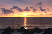 Sunrise at Paradisus: The rising sun shines on the water in front of the secluded beach at Paradisus Riviera Cancun Resort on September 24.