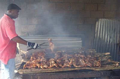 King Kong checking on the jerk chicken at Scotchies